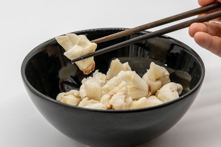 Close-up of person holding ice cream in bowl