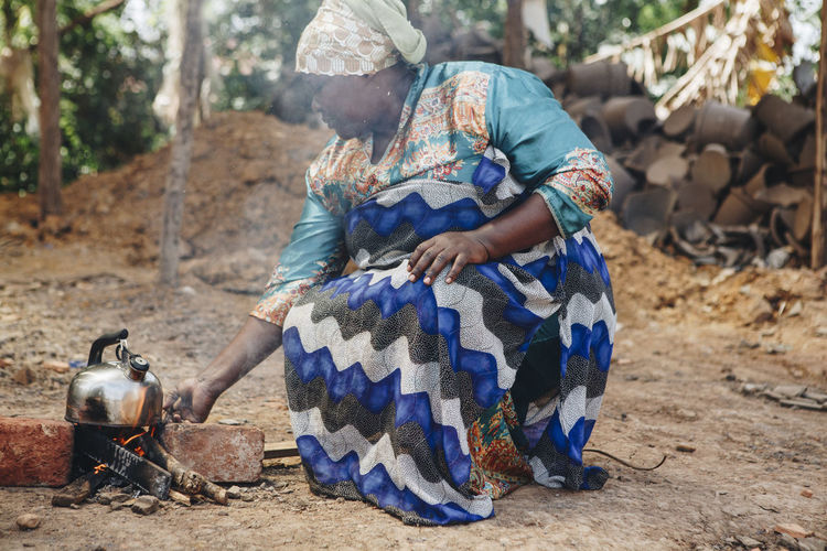 Africa African Burning Climate Change Dirt Energy Environmental Conservation Environmental Damage Environmental Issues Fire Firewood Fuel Lifestyles Outdoors Pollution Poor  Poverty Smoke Social Issues Stove Sustainability Traditional Clothing Traditional Culture Woman Wood