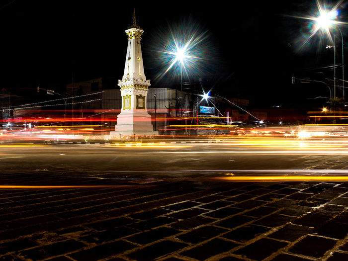 Low Exposure at Yogyakarta City Cityscape Illuminated Urban Skyline Statue Long Exposure Light Trail Arts Culture And Entertainment Motion Speed Street Light Traffic Gas Light Traffic Jam Stoplight Vehicle Light City Street High Street Town Square Tail Light Traffic Light  Headlight Road Intersection Multiple Lane Highway Rush Hour Icon Vehicle
