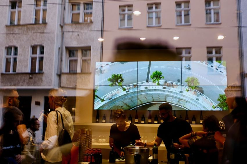 Horizn Photo Exhibition. Adult Adults Only Architecture Building Exterior Built Structure Cafe City Day Food And Drink Group Of People Large Group Of People Lifestyles Men Outdoors People Real People Sidewalk Cafe Sky Table Tree Women