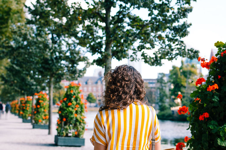 The Hague Fashion Woman Adult Beauty In Nature Blouse Casual Clothing Day Flower Flowering Plant Focus On Foreground Growth Hairstyle Leisure Activity Lifestyles Nature One Person Outdoors Plant Real People Rear View Standing Streetphotography Tree Women Yellow