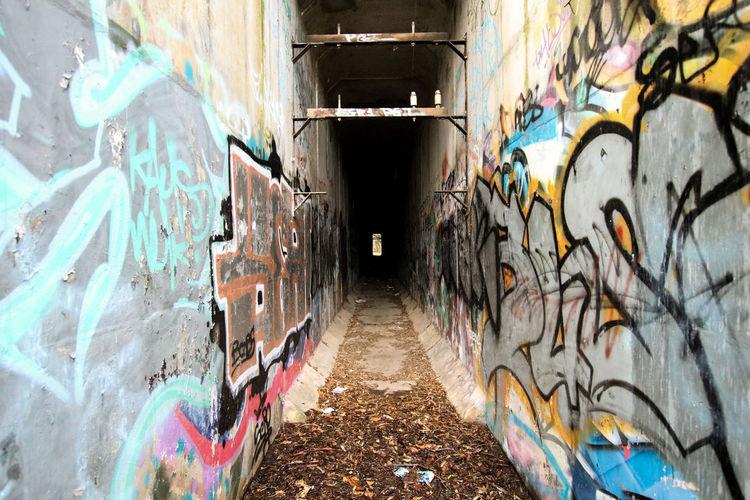 City Aerosol Can Spraying Painted Image Multi Colored Street Art Paint Spray Paint Graffiti Art And Craft Underground Walkway Underground Mural Wall Underpass Modern Art Scribble
