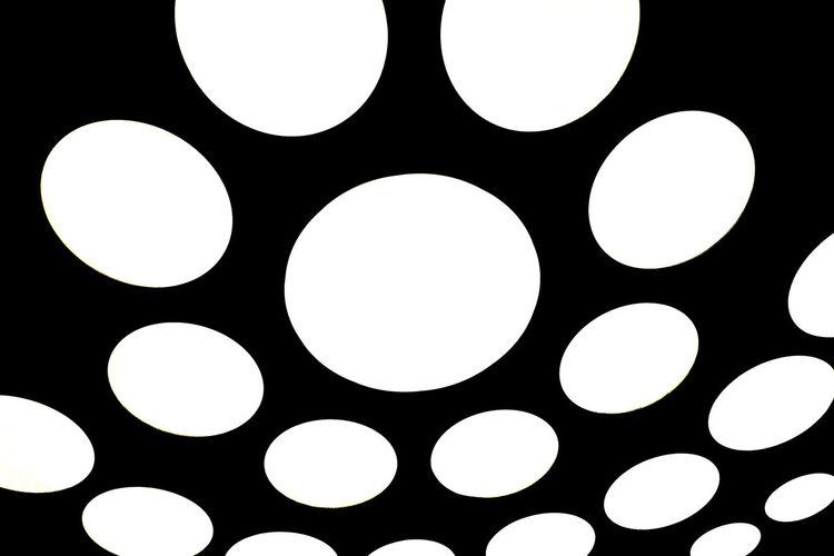Full frame shot of illuminated lights against black background