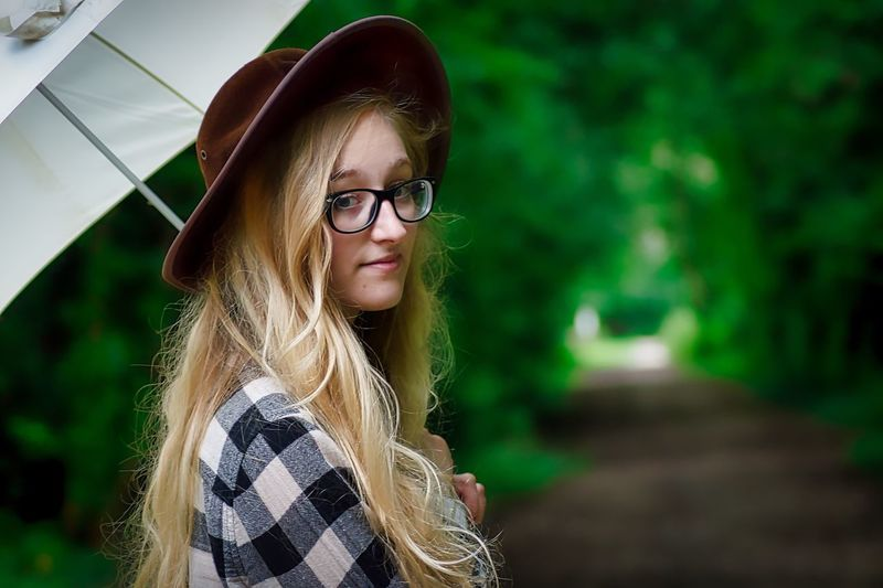 Happy Thursday everyone. Young Adult Young Women Long Hair Women One Person Outdoors Eyeglasses  Real People Portrait Day Adult Blond Hair One Young Woman Only Nature Close-up Adults Only People First Eyeem Photo EyeEmNewHere Nature Fashion Adults Only Umbrella Lifestyles Beautiful People The Week On EyeEm
