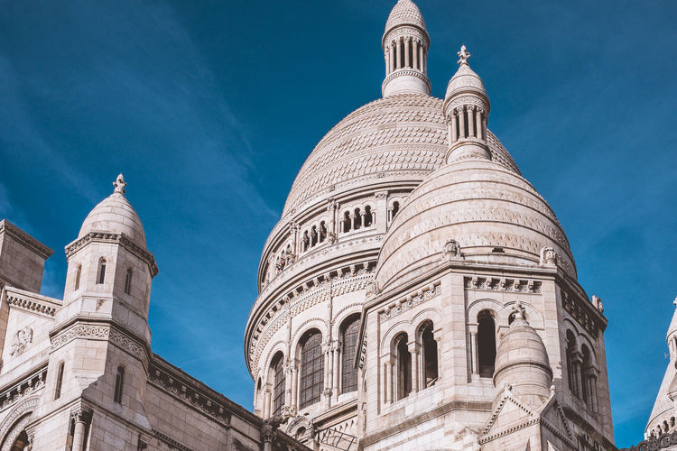 Architectures of Paris, France. Building Exterior Sky Low Angle View Built Structure Religion Architecture Spirituality Belief Place Of Worship Travel Destinations Dome Travel Tourism Nature Blue Building No People History The Past Outdoors Sacre Coeur Church