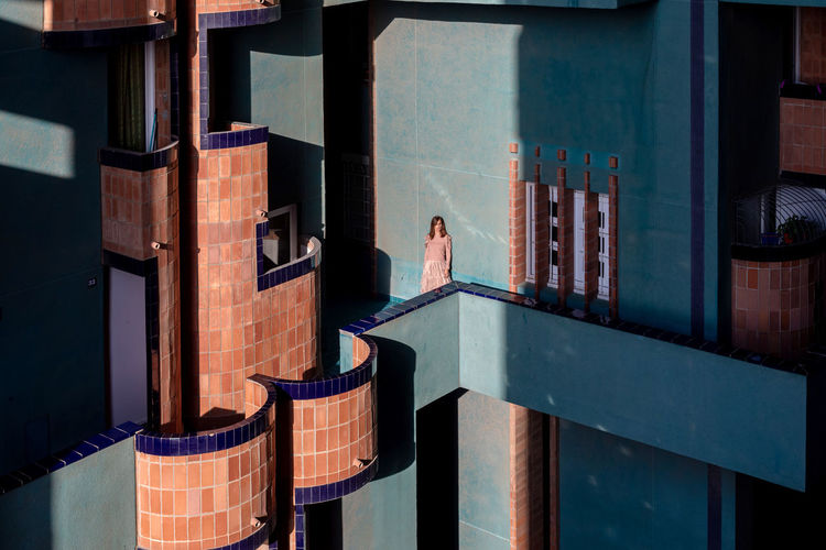 High angle view of woman standing on balcony