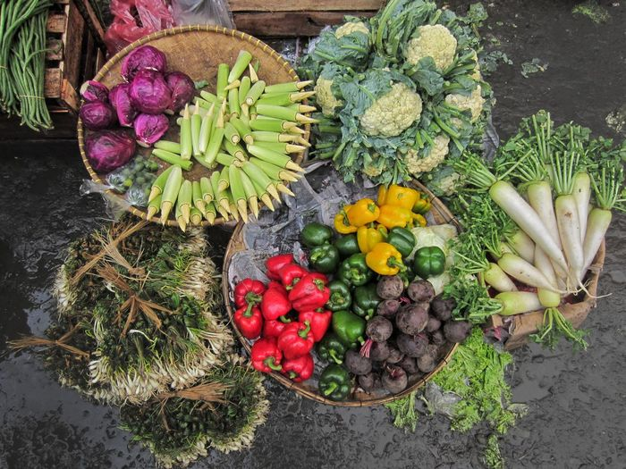High angle view of vegetables in baskets at market stall