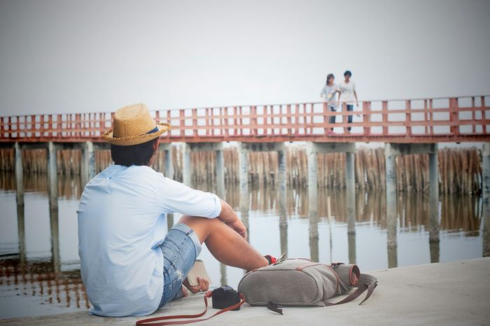 Asian broken heart man looking at lover on bridge, Vintage style color, Dark tone Adult Asian  Broken Broken Heart Casual Clothing Feeling Friendship Heart Lifestyles Love Lovers Point Men Motion Outdoors People Real People Sad & Lonely