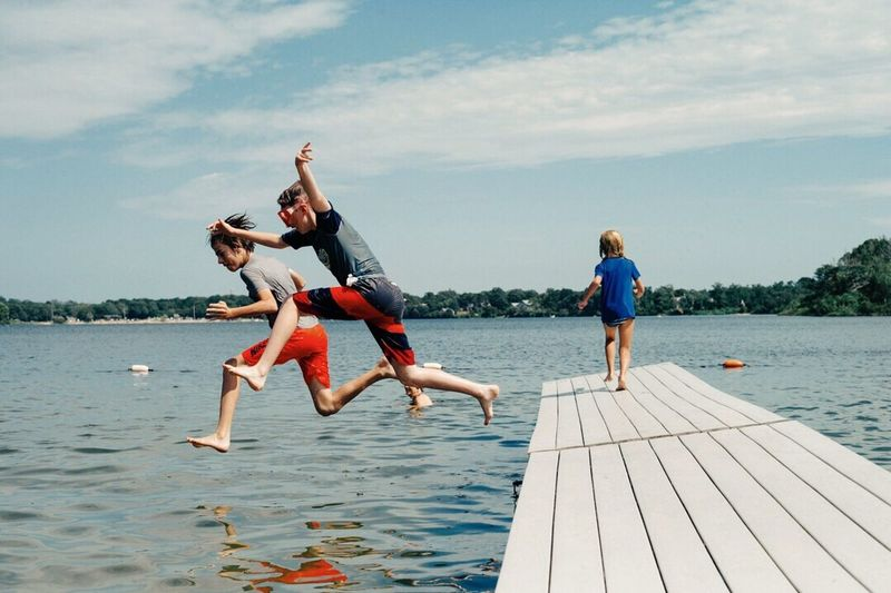 Children on Cape Cod Leisure Activity Water Lifestyles Jumping Lake Togetherness Mid-air Enjoyment Fun Motion swimming First Eyeem Photo Fresh On Eyeem
