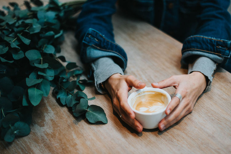 Food And Drink Human Body Part Table Real People Coffee - Drink Drink Lifestyles Human Hand Coffee Hand Refreshment Indoors  Cup Coffee Cup Mug High Angle View One Person Low Section Men Freshness Body Part Hot Drink Latte Autumn Eucalyptus Autumn Mood Holiday Moments