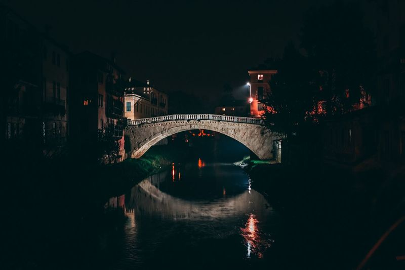 San Michele bridge - Vicenza EyeEm Selects Water Bridge Built Structure Architecture Bridge - Man Made Structure Night Illuminated Connection Transportation River City No People Nightlife Arch Bridge Arch Travel Destinations Waterfront Nature Building Exterior Reflection