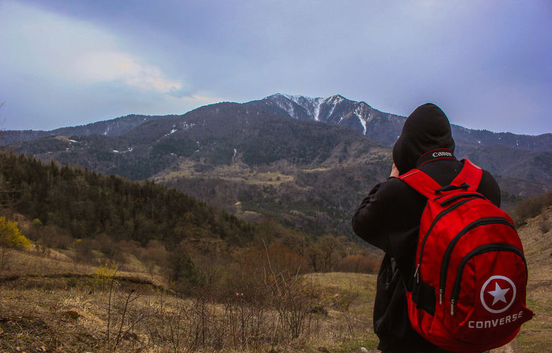 Adventure Backpack Beauty In Nature Cold Temperature Day Hiking Leisure Activity Lifestyles Mountain Mountain Range Nature One Person Outdoors People Real People Rear View Scenics Sky Snow Standing Warm Clothing Winter