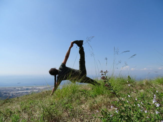 Yoga Yoga In Nature Relaxing Relax Green Landscape Water Spraying Irrigation Equipment Sea Clear Sky Sky Grass Horizon Over Water Meditating