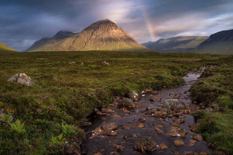 Buachaille Etive Glencoe Glencoe Mountain Resort Scotland Beauty In Nature Cloud - Sky Day Grass Highlands Landscape Mountain Nature No People Outdoors Rainbow Scenics Sky Tranquil Scene Tranquility Water
