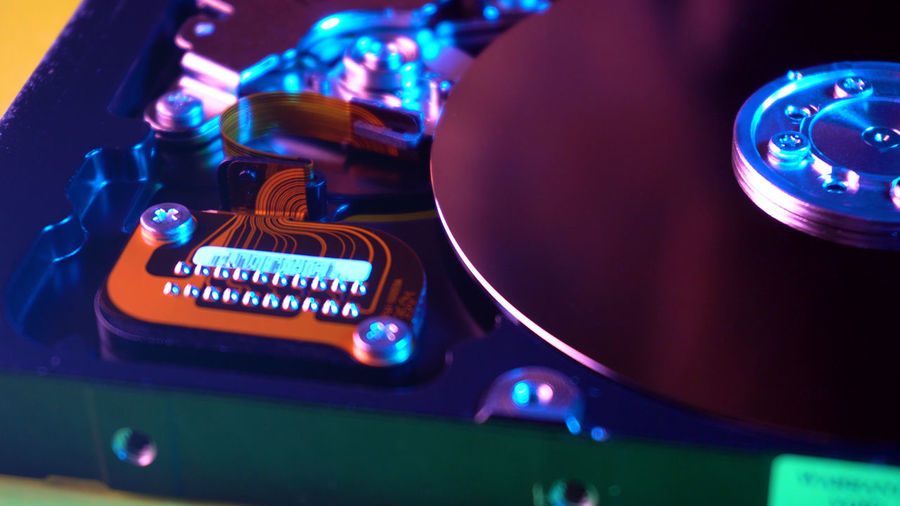 HDD drive closeup Technology Music Close-up Illuminated Arts Culture And Entertainment No People Indoors  Nightlife Text Equipment Communication Musical Equipment Musical Instrument Audio Equipment Focus On Foreground Number Western Script Still Life Light - Natural Phenomenon LED Electrical Equipment Purple