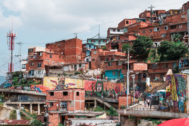 Medellin Colombia and the famous Comuna 13 Architecture Building Exterior Built Structure Building City Residential District Day Outdoors Sky Cloud - Sky Nature Connection No People Industry Machinery Technology Communication Graffiti Transportation Comuna 13 Comuna Colombia Slums Ghetto South America Streetphotography Art Grafitti Tele Cable