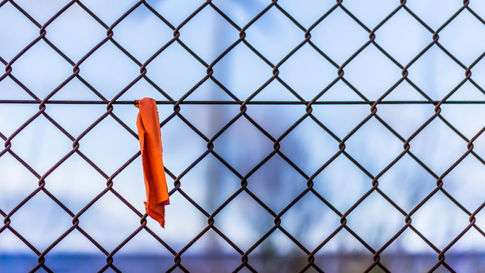Focus Object Backgrounds Close-up Day Fabric Focus On Foreground Metal No People Orange Color Outdoors Piece Of Cloth Protection Safety Scrap Security Selective Focus Sky Wire Mesh Fence