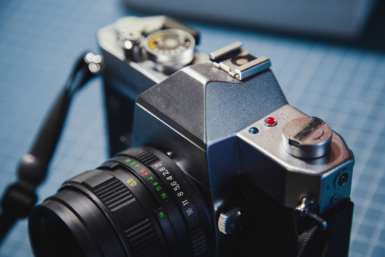 Close up of a film camera. Technology Camera - Photographic Equipment Photography Themes Photographic Equipment Camera Digital Camera Close-up Equipment Lens - Optical Instrument No People Indoors  Still Life Machinery High Angle View Table Focus On Foreground SLR Camera Photographing Retro Styled Film Film Photography Camera Photography