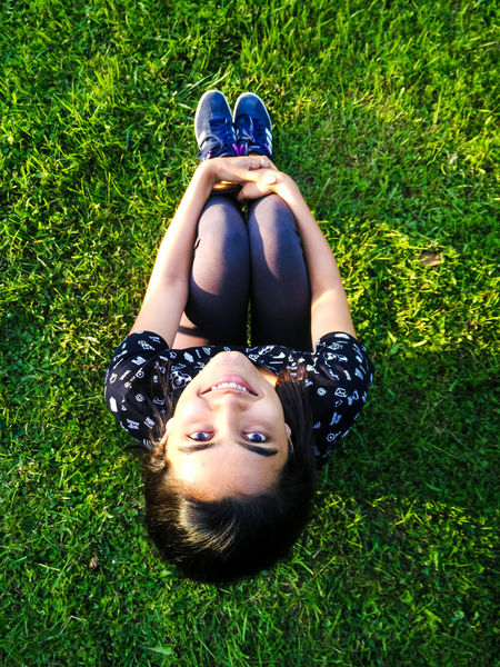 Happy young woman sitting on grass, looking at camera. Happiness Looking At Camera Sitting Beautiful Woman Black Hair Carefree Cheerful Full Length Grass Grassland High Angle View Leisure Activity Lifestyles Nature One Person Outdoors Portrait Real People Relaxation Summer Sunlit Beauty Sunlit Glow Women Young Adult Young Women The Week On EyeEm Mix Yourself A Good Time