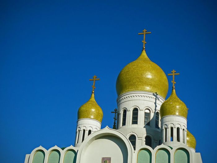 Low angle view of holy virgin cathedral against clear blue sky
