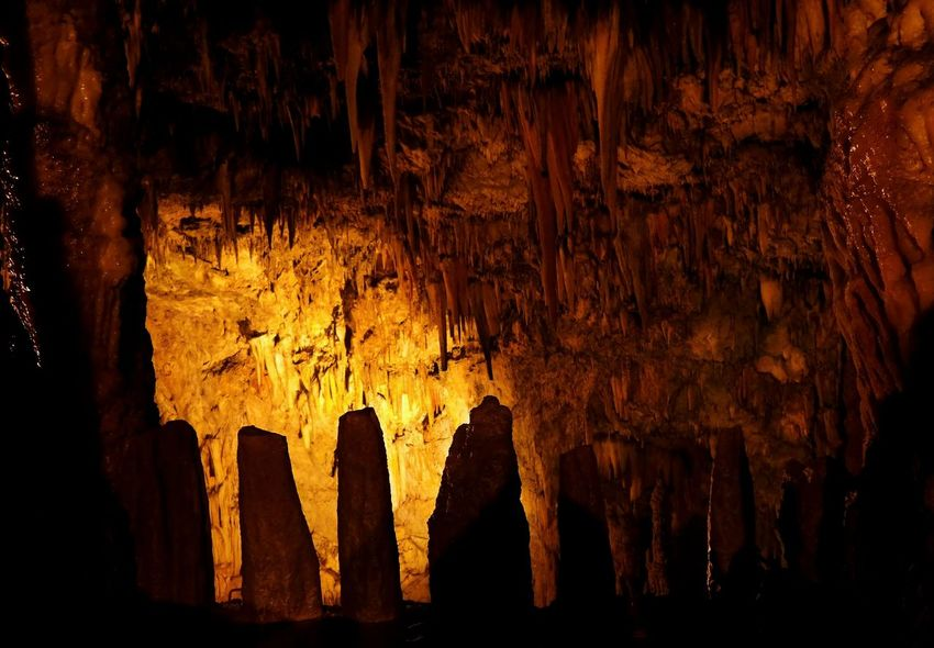 Stone Formation Beauty In Nature Cave Cave Photography Close-up Geology Illuminated Illuminated Background Indoors  Inside A Cave Low Angle View Nature No People Physical Geography Rock - Object Rock Formation Stalactite  Stone Teeth
