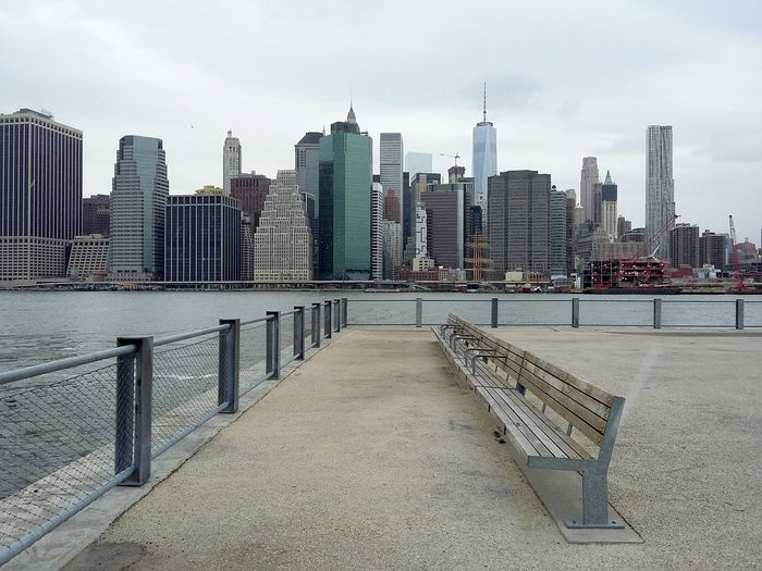Brooklyn, View on Manhattan. · New York City New York New York ❤ NYC USA Bench Benches Skyline Cityscape Architecture Urban Landscape Symmetry Pastel Cloudy Day Gray Sky