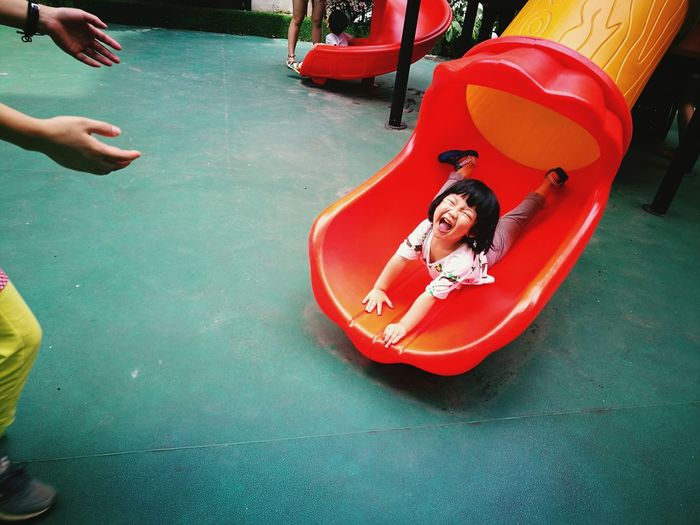High angle view of girl playing in play equipment at park
