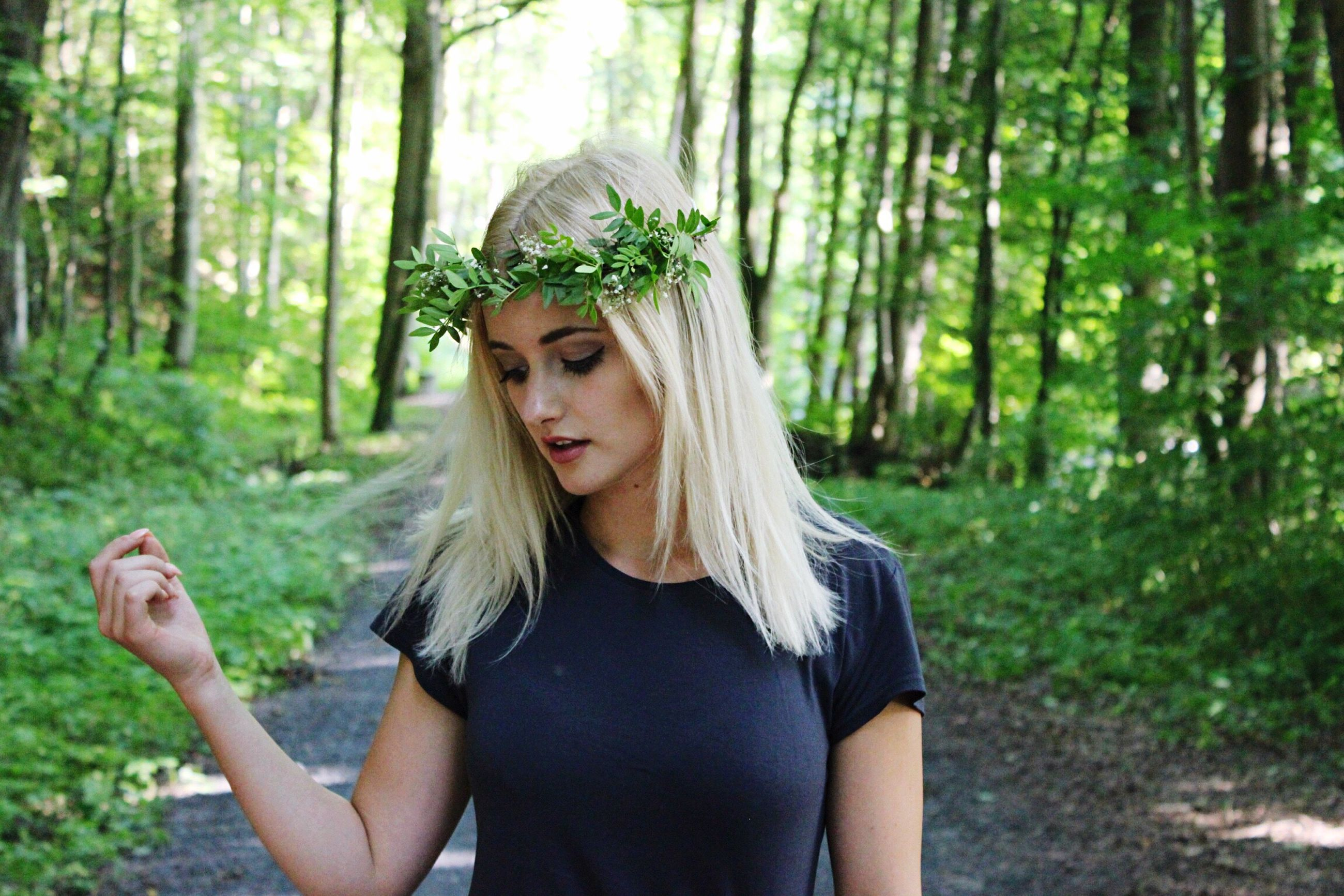 real people, young adult, forest, one person, lifestyles, nature, tree, young women, day, outdoors, blond hair, people