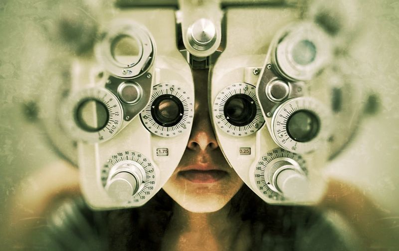 High angle view of eye test equipment over teenage girl