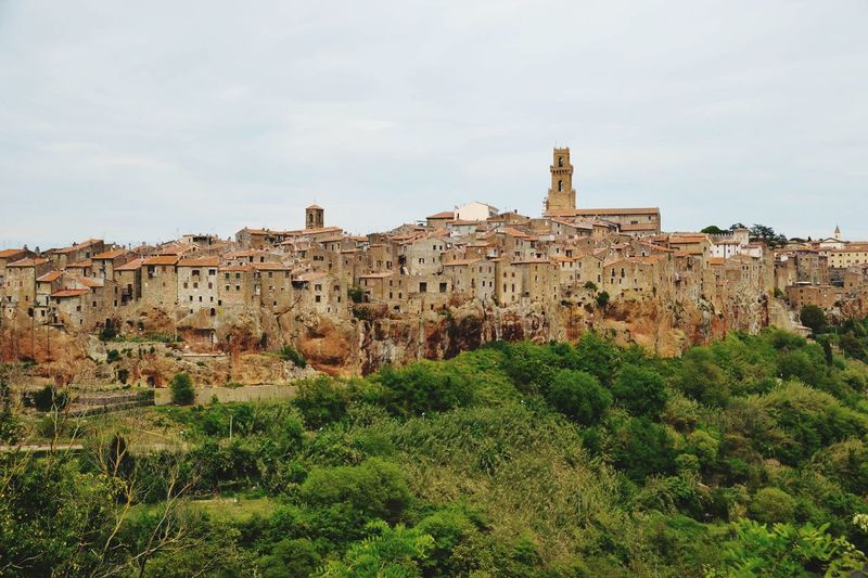 Old buildings in town against sky at pitigliano