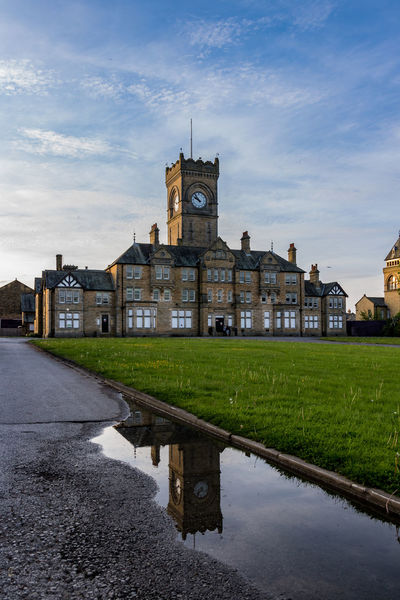 Architecture Asylum Building Exterior Built Structure City Cloud - Sky Day Grass History Menston No People Outdoors Puddle Reflection Sky Travel Destinations Water Waterfront
