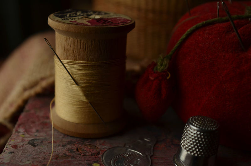 Close-up of thread spool on table