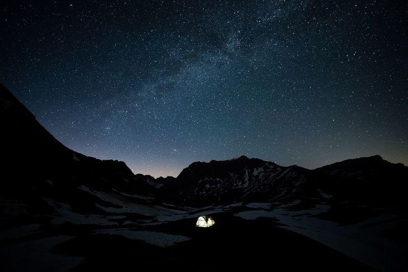 Illuminated tent on land at night