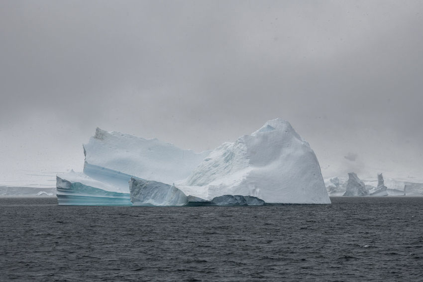 Iceberg in the Gerlache Strait, the Antarctic. Frozen Global Warming Icebergs Beauty In Nature Blue Climate Change Cold Temperature Environment Extreme Weather Glacier Ice Iceberg Iceberg - Ice Formation Landscape Nature No People Ocean Scenics - Nature Sea Seascape Snow Snowcapped Mountain Tranquility Water Winter
