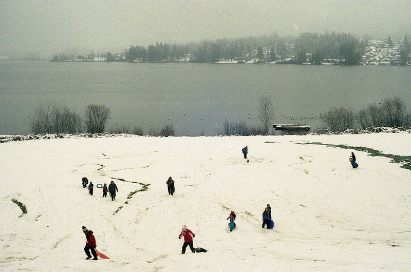People standing on snow covered field
