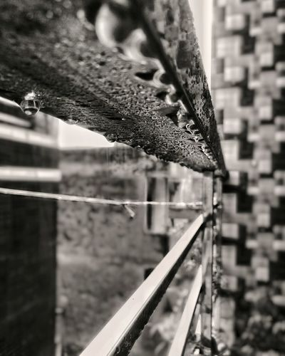 Tiny water droplets on steel railing after rain Water Water Droplets Droplets Bnw_collection Blackandwhite Vintage Look Perspective Converging Lines Guidelines Steel Steel Rail City Life City House Balcony View Rainy Days City Rain Mood Water Close-up Architecture Building Exterior Built Structure Dripping Monsoon RainDrop Wet Rain