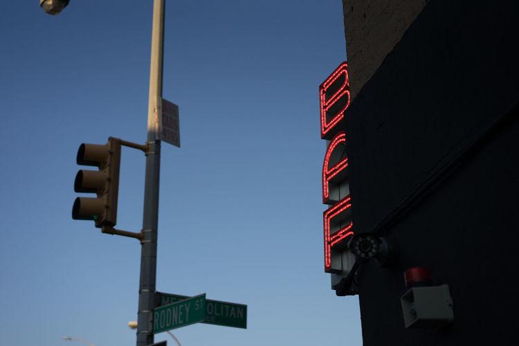 One night in Brooklyn Bar City Street Communication Guidance Illuminated Information Pole Road Sign Street Street Light Symbol Traffic