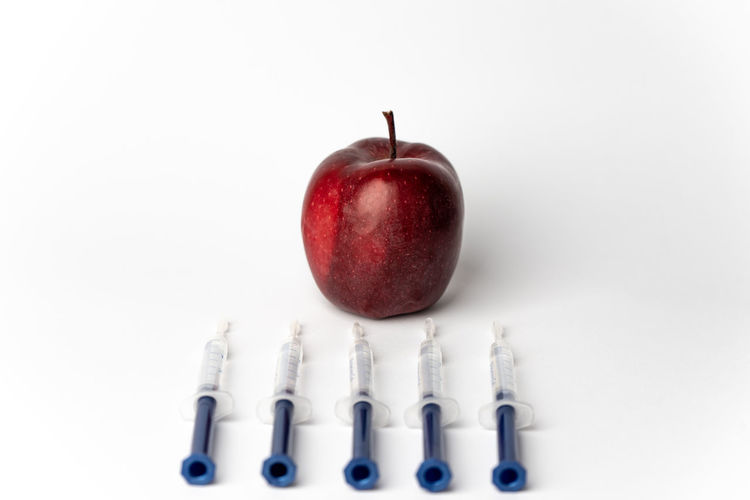 one apple a day take the doctor away Apple Vitamin Sickness Sick Health Health Care Injecting Injection Pesticide Clones Colne Testing Injection White Background Neat Studio Shot Red Close-up Bad Habit Addiction Syringe Vaccination
