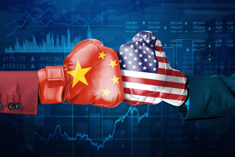 Cropped hands wearing boxing gloves with chinese and american flags against graph