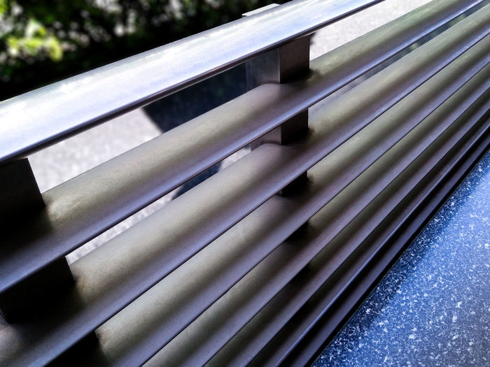 Aluminum Guard Rail on the Sidewalk Aluminum Can Aluminum Rail Architecture Backgrounds Close-up Corrugated Iron Day Guard Rail No People Outdoors Pattern Side View Urban