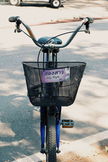 Communication Water Day Stationary Bicycle Basket Text Western Script Transportation No People Bicycle Land Vehicle Nature Metal Mode Of Transportation Close-up Basket Outdoors Focus On Foreground Hanging Message