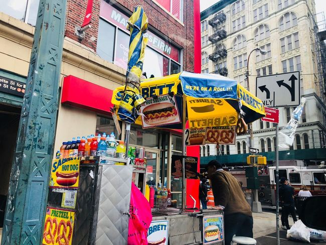 downtown New York HotDog Built Structure Architecture Multi Colored Building Exterior Choice City Day Sign Street Variation Business Outdoors Communication Market Building Retail  Store Hanging Text