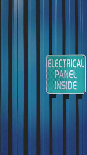 Sign board on blue corrugated iron
