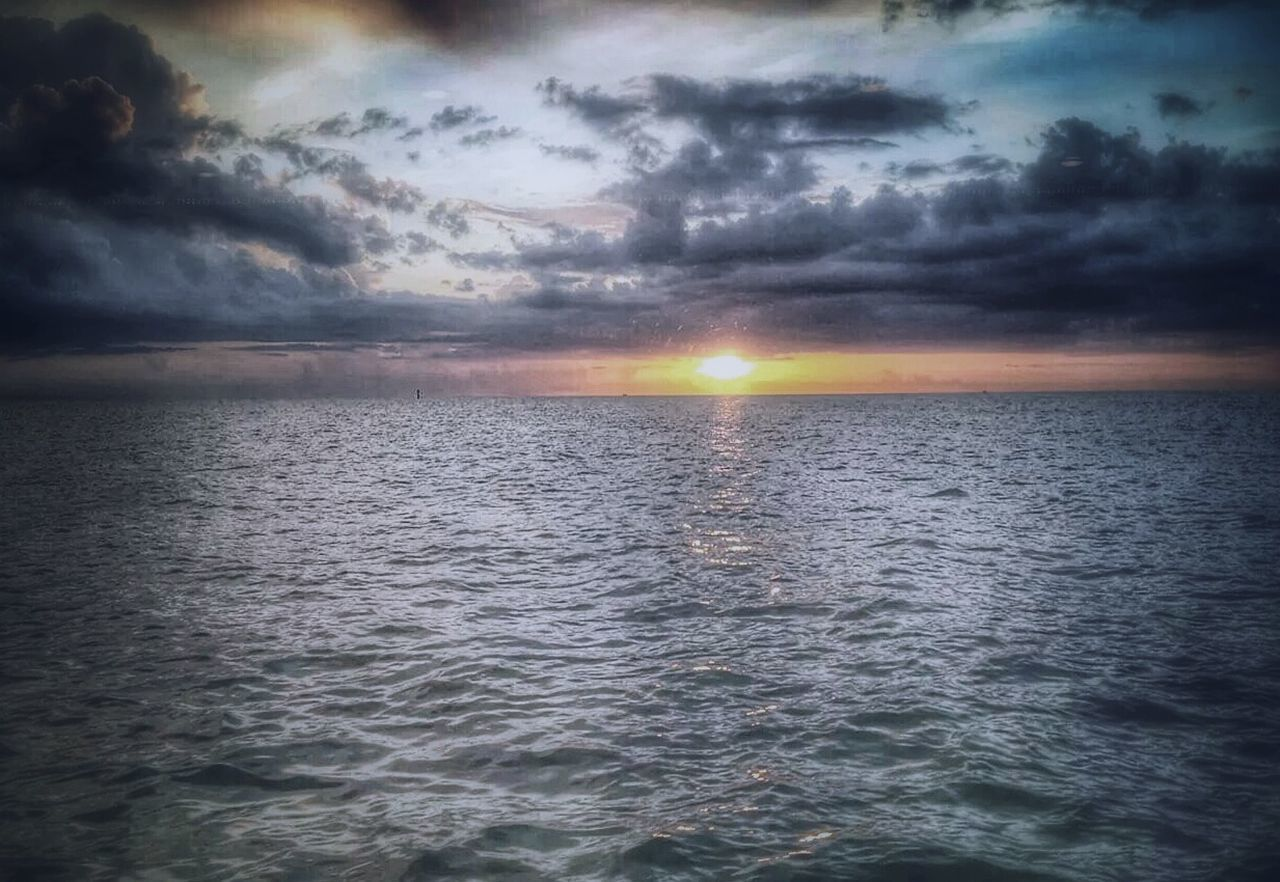 sea, scenics, beauty in nature, sunset, tranquility, nature, tranquil scene, water, cloud - sky, idyllic, sky, sun, sunbeam, rippled, no people, horizon over water, waterfront, outdoors, storm cloud, day