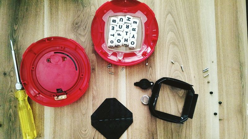 Indoors  Repairing Toys Game Boggle Dismantled Parts Wooden Base High Angle View No People Day Horizontal Red Close-up