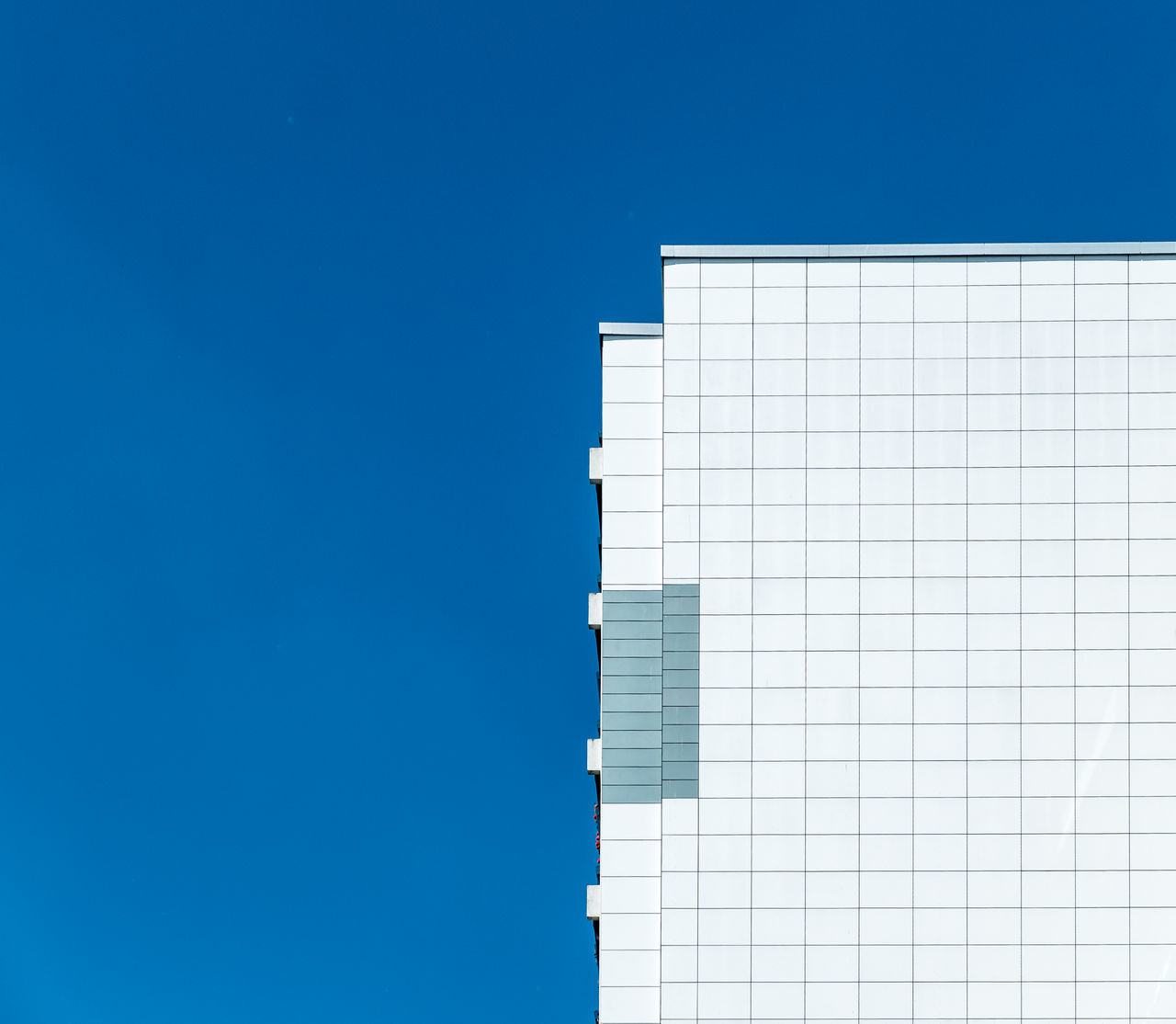 Cropped image of building against blue sky