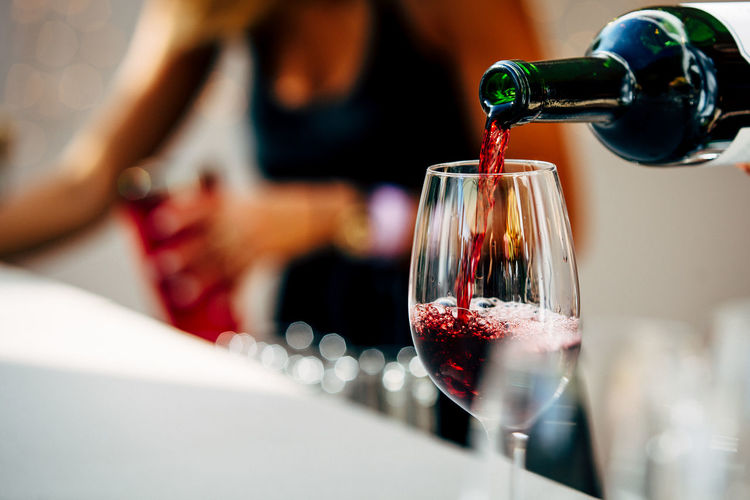 Close-up of wine pouring in glass