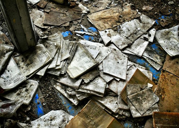 Close-up of abandoned objects on ground