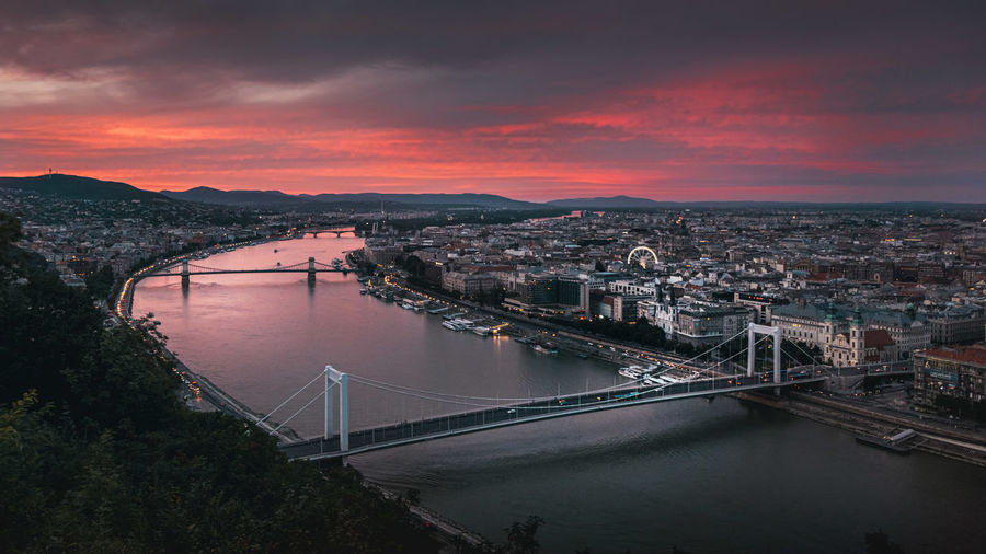 High angle view of suspension bridge over river during sunset