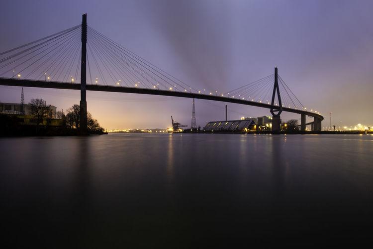 Illuminated suspension bridge over river